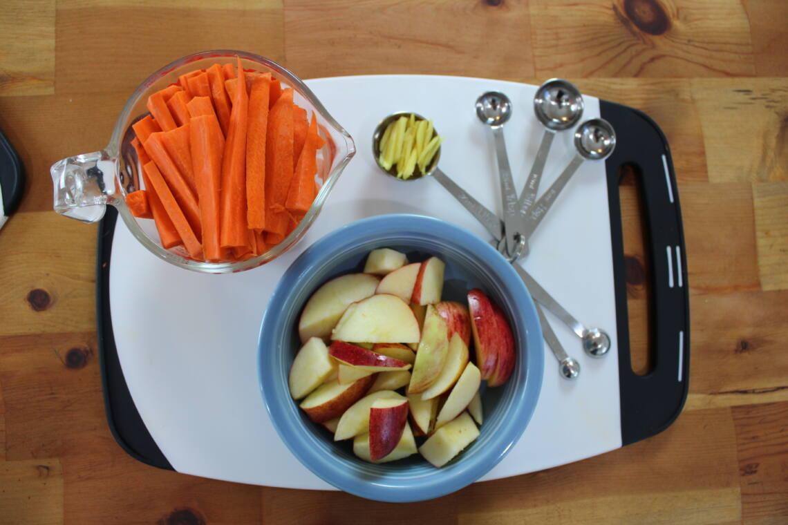 Ingredients measured for making carrot apple ginger juice