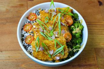 Vegan Tofu Katsu Bowl with broccoli, rice, and tomatoes