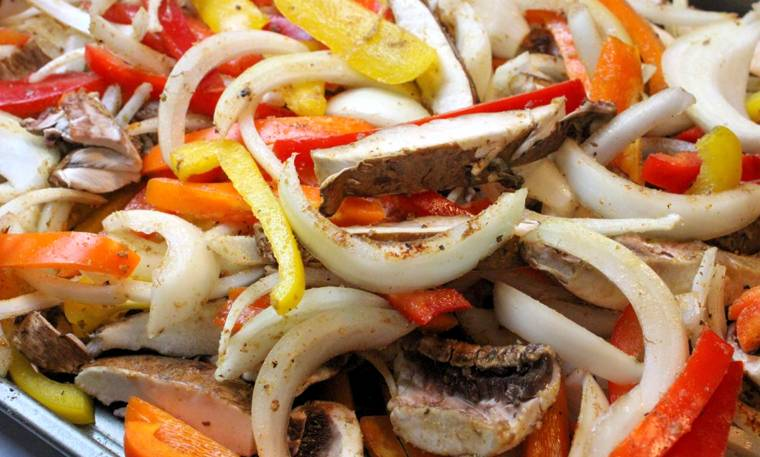 sliced vegetables on sheet pan