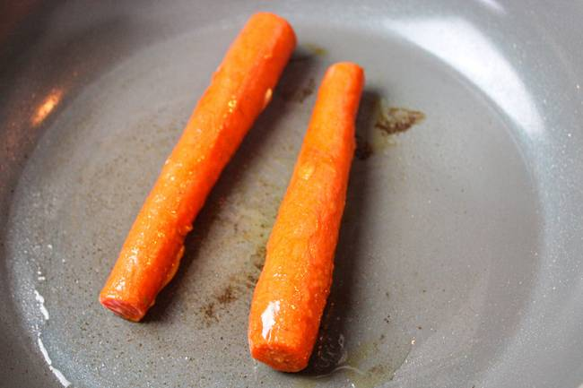 Carrots in a lightly oiled pan