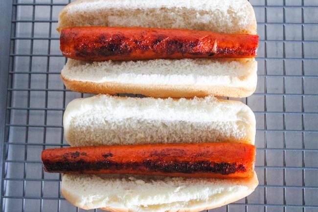 seared carrots in hot dog bun