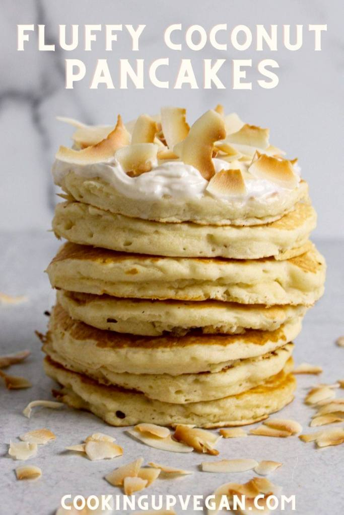 Stack of vegan pancakes with whipped cream and toasted coconut flakes